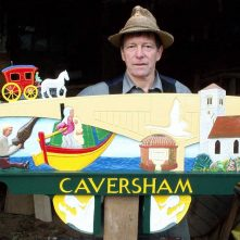 Stuart King with the Caversham sign