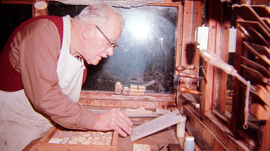 Andrew Oliver laying out marquetry components