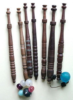 Seven bobbins turned by the same maker